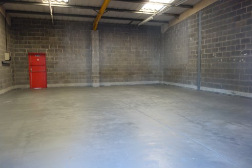 The unit has toilet facilities and a manual roller shutter door and could be suitable for a variation of uses including storage and light assembly.  The use of vehicle repairs are not permitted.