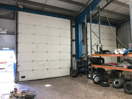 The property provides a modern industrial premises benefiting from a large surface and fenced yard to the front. The unit is accessed via two roller shutter doors and has an internal eaves height of approx. 5.2m (4.3m to the underside of the stanchio...