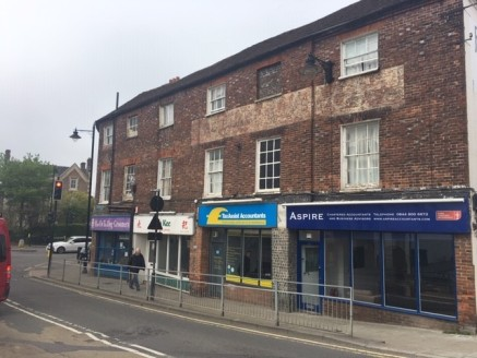 A ground floor retail unit with large display window benefitting from A1 & A2 uses.  Internally the space includes main retail / office area, beyond which is a large useful storage area with kitchenette and WC.  The property includes suspended ceilin...