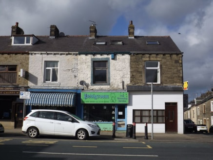 LOCATION\n\nThe property occupies a mid-parade position on Keighley Road which is a short distance from Colne town centre. North Valley Road (A6068), which links to Junction 14 of the M65 motorway is within a short distance drive....