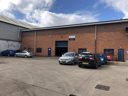 The subject property comprises an end terraced light industrial unit constructed in the late 1980's being of portal frame design with facing brick elevations set beneath a pitched insulated sheet roof.   Internally, the ground floor provides open pla...