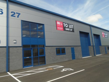 The property occupies a mid terraced position of five industrial units completed in 2018 and located close to the junction with Haslam's Lane.  The building is of steel portal frame construction with facing brick and composite panel elevations and fe...