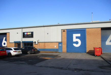 The property is a modern mid terrace industrial unit constructed around a steel portal frame with brick and metal profile cladding under a pitched profile sheet roof. The property benefits from: