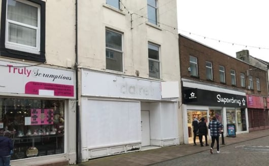 The property comprises three storey, mid terrace prime retail unit providing sales accommodation at ground floor level along with a staff room and WC/kitchen. The property benefits from an extensive glazed frontage incorporating DDA accessibility. In...