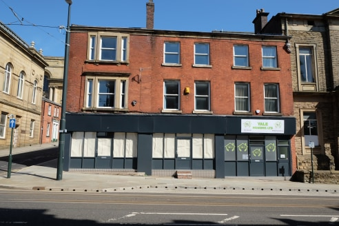 The property comprises a three storey, currently vacant commercial building which occupies an 'L' shaped footprint. The building is constructed in red facing brick under a shallow pitched slate covered roof.  The property has been extensively renovat...