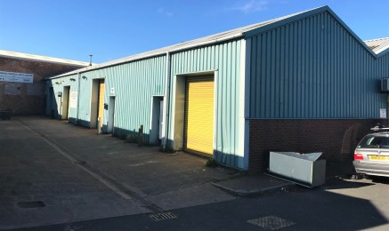 The property is divided into four industrial units and has been built with  steel frames with (majority) steel trussed roofs, lined internally. The units  have their own integral toilet facility and roller shutter entrance from the  communal access r...