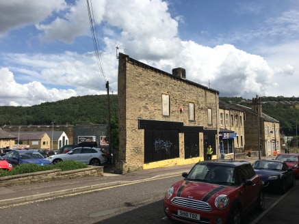 The property is a two storey with attic and basement stone built mixed retail and residential property under a dual pitched stone slate roof.  The property benefits from suspended timber upper floors and a stone flag solid basement floor. Internally...