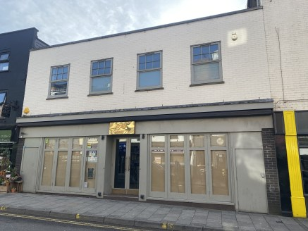 The property is of two storey brick constructions beneath a flat roof offering a wide double frontage, with fully opening display doors to the front and rear, extensively fitted ground and first floor bar/restaurant areas, extensive marbled bar count...