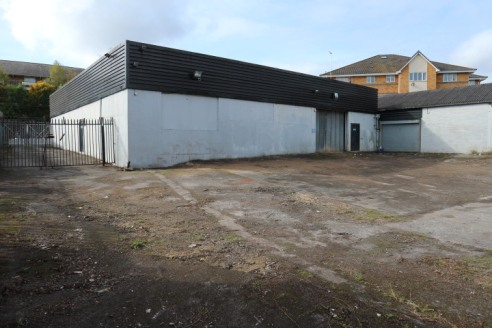 Prominent industrial / warehouse and showroom building with large secure car park / yard to the rear.