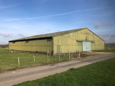 A detached former lambing shed of steel portal frame construction with Prior Approval for conversion into 3 residential dwellings with parking and bike & bin storage. Situated in an isolated yet accessible location with far reaching views from an ele...