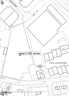 The site is a level surfaced area and provides open storage land enclosed by full height palisade fencing.
