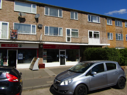 Neighbourhood Retail Investment.  Set behind a service road with generous parking provision the property comprises a terraced lock up ground floor shop. The shop is well proportioned and includes a large rear store, office and WC. To the rear there i...