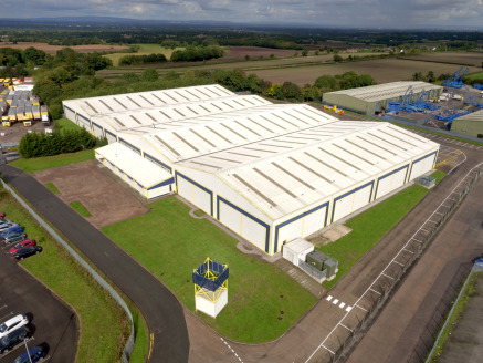 Less than 1 mile from Jct 20 / M6 and Jct 9 M56. Modern portal frame warehouse. Eaves height of 7 metres. 4 dock level loading doors with the ability to provide and additional 4. 2 level loading doors. 45 metre yard depth. Two storey modern office ac...