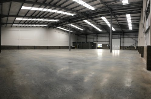 The property forms part of a terrace of 3 brand new industrial units which are of steel frame construction with clad elevations incorporating the following:-
