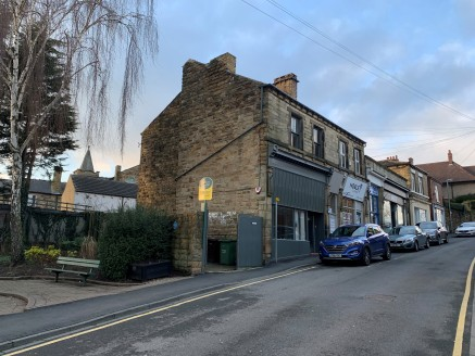 The property comprises a two-storey former Coop Funeral premises set within a stone-built parade of shops in the centre of Horbury. The property offers a ground floor retail unit with the option for residential conversion at first floor. Access to th...