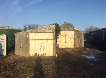 The property comprises a basic workshop / store building.  The property includes two loading doors to the front, 2 pedestrian doors to the rear, maximum door height of 3m, concrete floor and 3 parking spaces to the front.