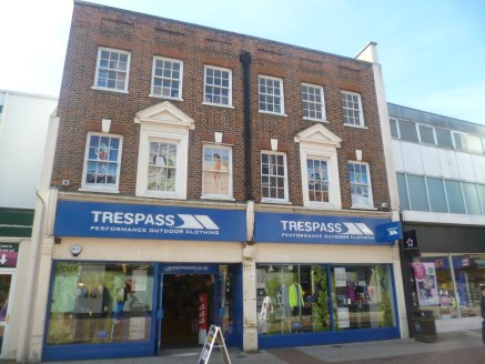 The property comprises a substantial, double fronted retail unit with rear storage and servicing via Black Horse Lane, first floor sales and second floor stock rooms and kitchen.