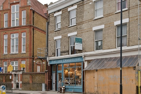 A GROUND FLOOR SHOP & PREMISES (A1), LOOKING ONTO LILLIE ROAD, & 4 FLATS (C3)\n\nOverview\n\nFor Sale\n\nAn attractive flat fronted, end of terrace, Victorian building with a glazed ground floor frontage, leading to a retail area and a second retail....
