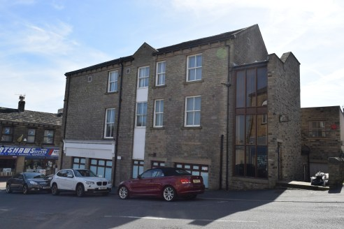 The property briefly comprises a former bank fronting on to Coronation Street and Southgate, the main road running through Elland Town Centre.  The ground floor and basement retail unit are currenty let on a 6 year Full Repairing and Insuring (FRI) l...