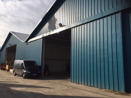 The main accommodation consists of a modern two storey office building which is of steel frame construction with composite clad elevations set beneath a flat roof.   Adjacent to this building are the principle workshops which comprise a terrace of in...