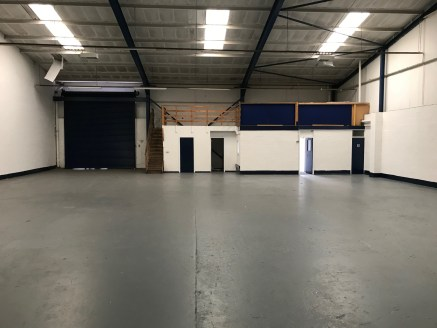 Unit 1 is an end of terrace industrial unit, the premises is a mainly open plan warehouse with the benefit of two internal offices and separate kitchen.  Access is via a roller shutter door and the estate is fully fenced with lockable secure gates. C...