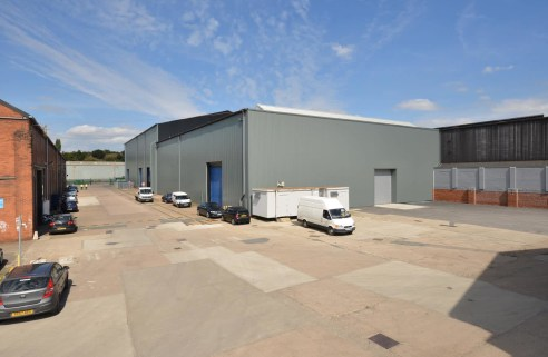 This is a high bay heavy industrial workshop unit extending to approximately 16,951 sq ft (1,574.76 sq m) with the following specification: