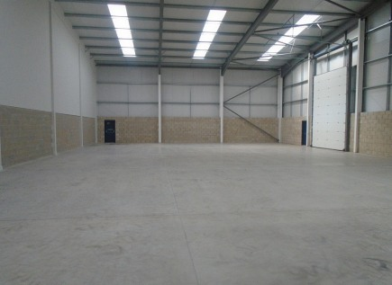 The property forms part of a terrace of five industrial units completed in 2018 and located close to the junction with Haslam's Lane.  The building is of steel portal frame construction with facing brick and composite panel elevations and feature pic...
