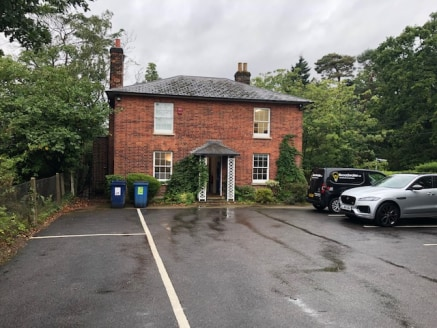 Detached character office building with extensive car parking next to Weybridge railway station