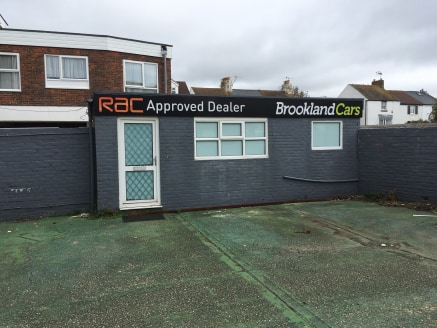 * Former car showroom To Let  * Ground floor retail /office space included  * Self contained rear yard  * Would suit alternative uses including retail  * Prominent position on busy road   * W/C Facilites   * Water Supplies  * Electricity