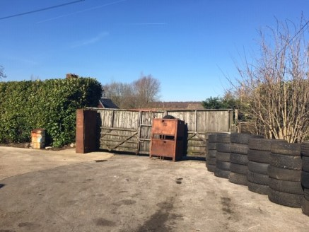 The property comprises a former vehicle yard of some 0.49 acres with planning permission for 3 detached dwellings under planning reference 18/00377.  The dwellings comprise 2 x 3 bedroom and 1 x 4 bedroom. The sizes are 1,499 sq. ft x 2 and 2,583 sq....