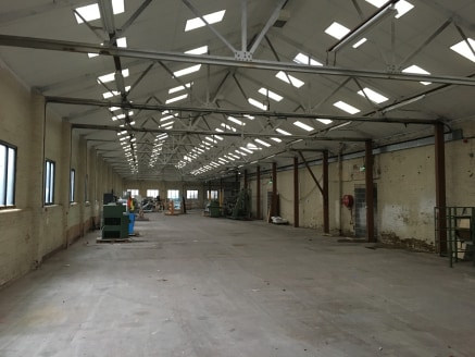 Unit J  The property briefly comprises a single storey industrial unit benefiting from from:  Drive in access via two separate electric roller shutter doors;  Minimum 4.21M internal working eaves height;  Solid concrete flooring;  Fluorescent strip l...