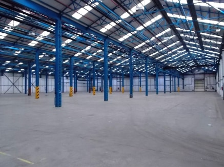 "5 bay warehouse/production unit with full height concrete panel walls externally clad in profile metal sheet. Level loading facilities, together with covered dock level facility. Clear eaves 7.83m (25'8"") Detached single storey office block New lease..."