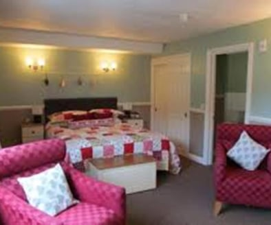 Freehold 13 Bedroom Guest House & Cafe In Looe For Sale\n2 Separate Owners Apartments\n4 Star Rated (Blue Flag)\nLicensed\nScope for Touring Pitches\nRef 2076\n\nLocation\nThis respected Guest House & Restaurant enjoys a desirable and prominent tradi...