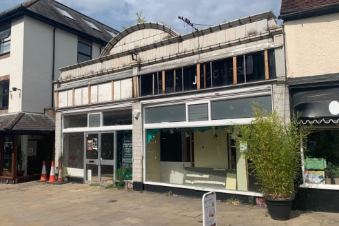 The building is currently a single storey retail unit with ancillary storage. To the rear of the premises there is a small covered storage area as well as rear loading access and parking.