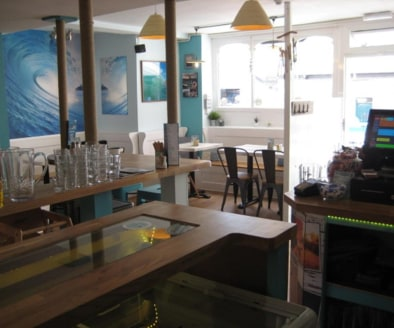 Trendy Licensed Cafe Located In St Agnes\nExternal Seating\nRef 2400\n\nLocation\nThis delightful Cafe is located in the Cornish sea side village of St Agnes. The Village has a population of circa 7,565 and sits in both a designated Area of Outstandi...