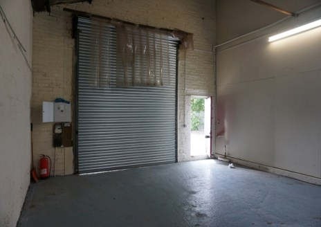 The unit comprises single storey industrial/warehouse accommodation, being of steel portal frame construction with a pitched roof incorporating translucent roof lights, part brick part boarded elevations. The unit has a concrete floor and is lit by f...