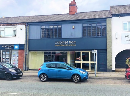 A double fronted retail premises with approx 35 feet roadside frontage and a ground floor sales area extending to 981 sq.ft.