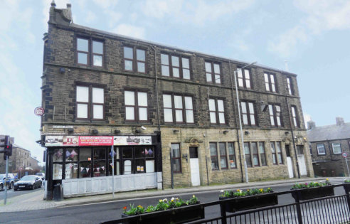 LOCATION\n\nThe property occupies a prominent main road position on the corner of Keighley Road and Newtown Street in an established retail location on the outskirts of Colne town centre. Other occupants in the immediate vicinity include Job Centre P...