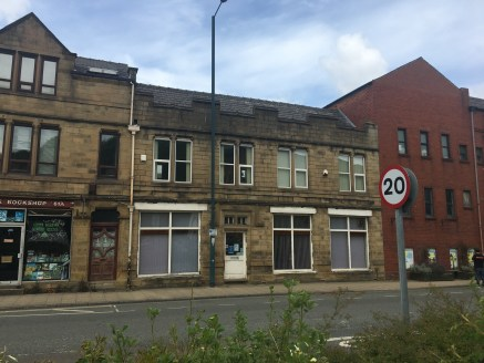 The property briefly comprises a part single and part two storey mixed workshop and office building in a parade of properties having pedestrian access from the front directly onto Halifax Road together with separate loading access to the rear and ded...