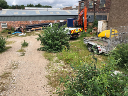 The property comprises a pair of interconnected industrial/warehouse buildings of brick elevations supporting various pitched roof surfaces with open plan working areas together with a rear yard and car parking to the front extending to 0.25 acres.
