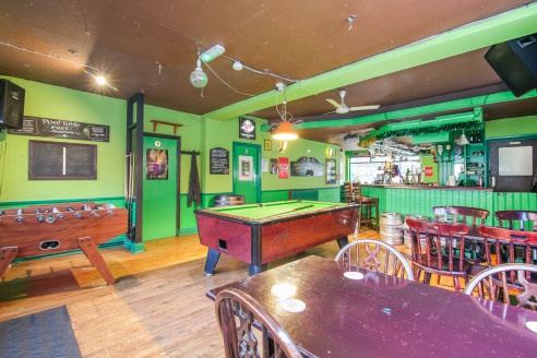Assignment of the current lease with expiration on 31st August 2023. Seeking premium offers in the region of £20,000.   The property, set across three floors, currently operates as a pub with hostel lodging upper parts. The ground floor has an open-p...