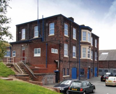 Detached purpose built office building with a mixture of cellular and open plan office space arranged over ground and 1st floor. Storage is available in the lower ground floor basement. Secure car park.