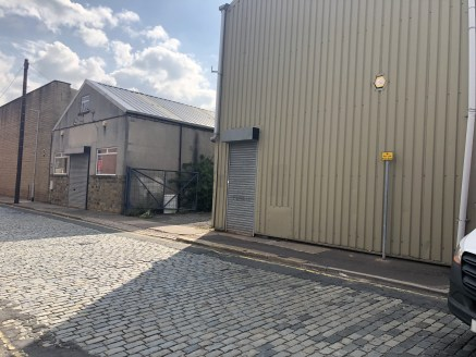 The property briefly comprises a trade counter industrial unit benefitting from two further adjoining warehouses. All units can be accesses internally and benefit from solid floors, WC facilities and concertina security loading door access. There is...