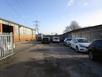 The property comprises a single warehouse/industrial unit with an attached single storey flat roof office. The warehouse is constructed with a steel portal frame with masonry walls to half height under a sheeted roof. The warehouse has a minimum eave...