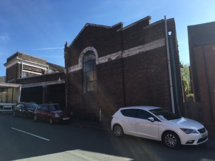 The property comprises a ground floor workshop / storage premises of masonry and block work construction beneath a pitched, steel truss roof. The warehouse is arranged over split levels, being open plan and also benefiting from WC's and a kitchen fac...