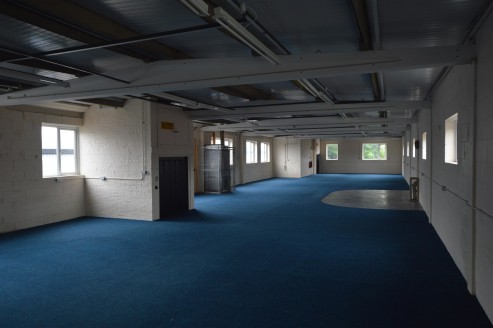 The property comprises a semi-detached industrial unit with brick elevations under a new pitched roof. The ground floor includes warehouse space benefiting from two concertina loading doors, warehouse lighting, reception / entrance area and toilet fa...