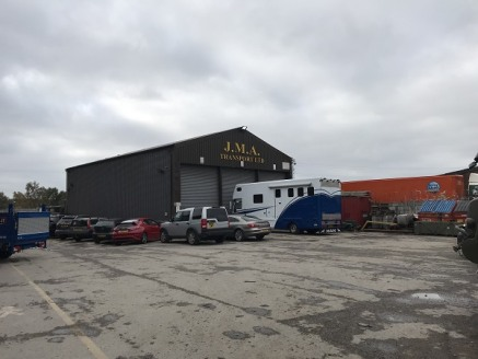 The site is approximately 0.812 acres in size and benefits from being fully enclosed. There are two buildings comprising a workshop and warehouse. Access is gained via electric gates.  The workshop is of steel portal frame construction with profile s...