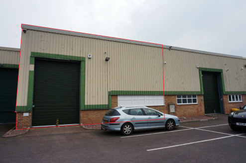 Modern Warehouse Unit\nIncludes mezzanine floor, roller shutter door, offices, staff facilities and parking\nGround Floor: 179.10 sq m (1,927 sq ft) Mezzanine: 12.97 sq m (140 sq ft)\nTotal Gross Internal Area: 192....