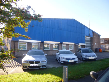 The property comprises a detached warehouse premises of steel portal frame construction with brick elevations beneath a pitched asbestos sheet roof.  Internally, the accommodation provides predominantly open plan warehouse space but with a section of...