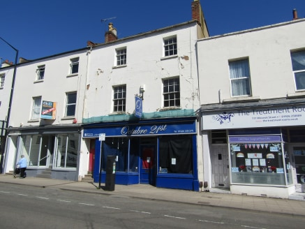 Town Centre Retail & Residential Investment For Sale Freehold.  Ground Floor Lock Up Shop with two, vacant one bedroom flats above.  Attractive Town Center Location  Shop let to Octubre 21st Ltd. Current rent £13,500 pa. The lease is drawn on interna...